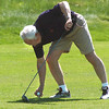 Milo Olsen sets the ball on his tee before teeing off of the 9th hole during the Broomfield Evening Rotary Club's Frank Varra Memorial  Broomfield Police and North Metro Fire District Benefit Golf Tournament at the Broadlands Golf Course on Monday.<br /> May 23, 2011<br /> staff photo/David R. Jennings