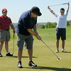 Shane Letcher, left, with Jeff Mitchell watch Rich Jacobs make a putt on the 9th green during the Broomfield Evening Rotary Club's Frank Varra Memorial  Broomfield Police and North Metro Fire District Benefit Golf Tournament at the Broadlands Golf Course on Monday.<br /> May 23, 2011<br /> staff photo/David R. Jennings