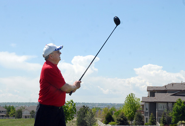 Bill Ayers tees off of the 1st hole  during the Broomfield Evening Rotary Club's Frank Varra Memorial  Broomfield Police and North Metro Fire District Benefit Golf Tournament at the Broadlands Golf Course on Monday.<br /> May 23, 2011<br /> staff photo/David R. Jennings