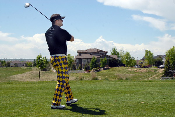 Steve Higgins tees off on the 1st hole during the Broomfield Evening Rotary Club's Frank Varra Memorial  Broomfield Police and North Metro Fire District Benefit Golf Tournament at the Broadlands Golf Course on Monday.<br /> May 23, 2011<br /> staff photo/David R. Jennings