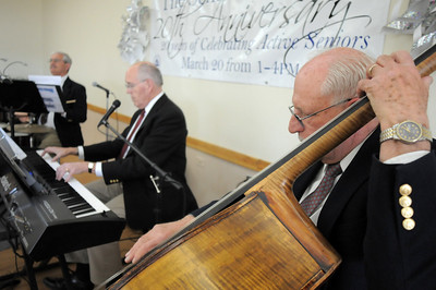 The Rob Tate Trio, Ted Worth at drums, Rob Tate at keyboard and Thomas Severino at bass entertains during the 20th anniversary celebration of the Broomfield Senior Center on Sunday. March 20, 2011  staff photo/David R. Jennings
