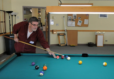 Tom Russeau tests his skill at billiards during the 20th anniversary celebration of the Broomfield Senior Center on Sunday. March 20, 2011  staff photo/David R. Jennings