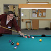 Tom Russeau tests his skill at billiards during the 20th anniversary celebration of the Broomfield Senior Center on Sunday.<br /> March 20, 2011<br />  staff photo/David R. Jennings