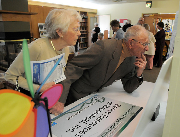 Jean and Dr. Bill Markel look at pictures on a display during the 20th anniversary celebration of the Broomfield Senior Center on Sunday.<br /> March 20, 2011<br />  staff photo/David R. Jennings