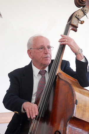 Thomas Severino plays the bass for the Rob Tate Trio  during the 20th anniversary celebration of the Broomfield Senior Center on Sunday.<br /> March 20, 2011<br />  staff photo/David R. Jennings