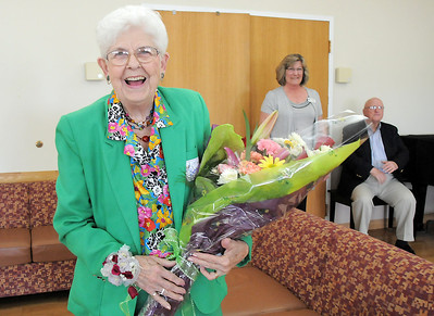 Betty Calvin smiles after receiving flowers to honor her volunteer service at the senior center for 20 years during the 20th anniversary celebration of the Broomfield Senior Center on Sunday. March 20, 2011  staff photo/David R. Jennings