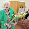 Betty Calvin smiles after receiving flowers to honor her volunteer service at the senior center for 20 years during the 20th anniversary celebration of the Broomfield Senior Center on Sunday.<br /> March 20, 2011<br />  staff photo/David R. Jennings