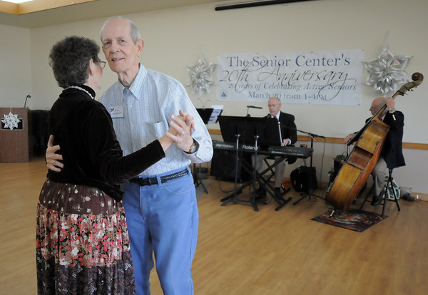 Doris and Alan Willimont dance to the tunes of the Rob Tate Trio during the 20th anniversary celebration of the Broomfield Senior Center on Sunday.<br /> March 20, 2011<br />  staff photo/David R. Jennings