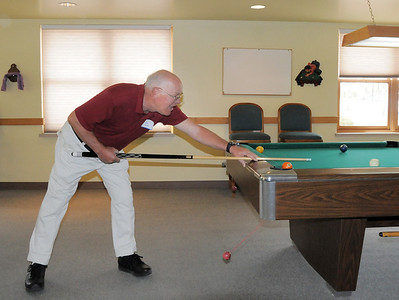 John Kesig plays a game of billiards during the 20th anniversary celebration of the Broomfield Senior Center on Sunday. March 20, 2011  staff photo/David R. Jennings