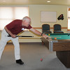 John Kesig plays a game of billiards during the 20th anniversary celebration of the Broomfield Senior Center on Sunday.<br /> March 20, 2011<br />  staff photo/David R. Jennings