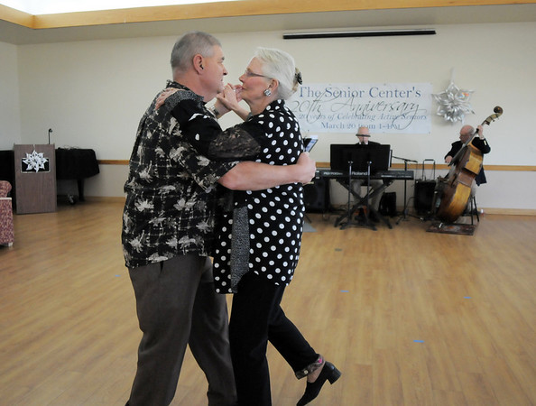 Bob Randolph and Jan Spratte dance to the music of the Rob Tate Trio during the 20th anniversary celebration of the Broomfield Senior Center on Sunday.<br /> March 20, 2011<br />  staff photo/David R. Jennings