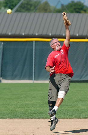 Mike Scott-Burke reaches to try and catch the ball during Wednesday's senior softball game pitting the Broomfield Frontline team against the Lakewood Cougars at Community Park.<br /> <br /> August 3, 2011<br /> staff photo/ David R. Jennings
