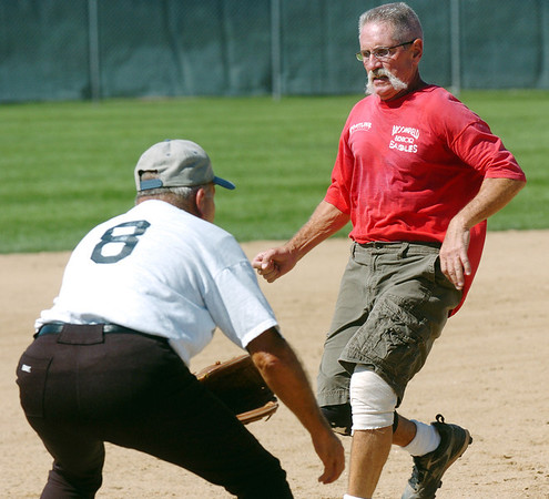 Mike Scott-Burke, right, runs safely to third base during Wednesday's senior softball game pitting the Broomfield Frontline team against the Lakewood Cougars at Community Park.<br /> August 3, 2011<br /> staff photo/ David R. Jennings