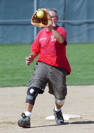 Mike Scott-Burke catches the ball at second base during Wednesday's senior softball game pitting the Broomfield Frontline team against the Lakewood Cougars at Community Park.<br /> <br /> August 3, 2011<br /> staff photo/ David R. Jennings