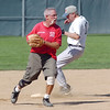 Mike Scott-Burke prepares to throw to first base after making a forced out at second during Wednesday's senior softball game pitting the Broomfield Frontline team against the Lakewood Cougars at Community Park.<br /> August 3, 2011<br /> staff photo/ David R. Jennings