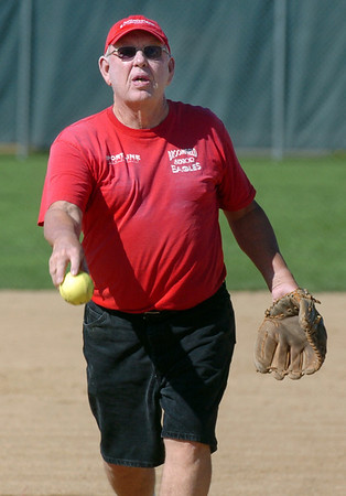 Ken Newsom pitches during Wednesday's senior softball game pitting the Broomfield Frontline team against the Lakewood Cougars at Community Park.August 3, 2011<br /> staff photo/ David R. Jennings