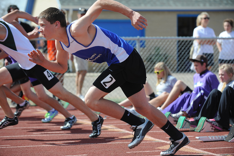 Lyon's Zac Christiansen launches off the blocks for the 110m hurdles during the Broomfield Shoot Out Track Meet on Friday at Elizabeth Kennedy Stadium in Broomfield.<br /> March 30, 2012 <br /> staff photo/ David R. Jennings