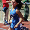 Longmont's Sam Cropp running in the 800 medly relay during the Broomfield Shoot Out Track Meet on Friday at Elizabeth Kennedy Stadium in Broomfield.<br /> March 30, 2012 <br /> staff photo/ David R. Jennings