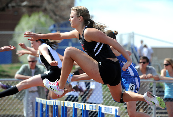 Fairview's Nissa Gunderson running in the 100m hurdles during the Broomfield Shoot Out Track Meet on Friday at Elizabeth Kennedy Stadium in Broomfield.<br /> March 30, 2012 <br /> staff photo/ David R. Jennings