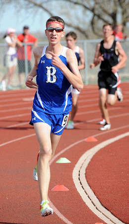 Broomfield's Cody Armstrong in the turn for the 1600m run during the Broomfield Shoot Out Track Meet on Friday at Elizabeth Kennedy Stadium in Broomfield.<br /> March 30, 2012 <br /> staff photo/ David R. Jennings