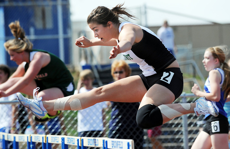 Niwot's Victoria Schultz clears a hurdle in the 100m hurdles during the Broomfield Shoot Out Track Meet on Friday at Elizabeth Kennedy Stadium in Broomfield.<br /> March 30, 2012 <br /> staff photo/ David R. Jennings