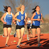 Broomfield's Anna Grace Knudtse, center, and Shannon Duffy keep pace in the 800m run during the Broomfield Shoot Out Track Meet on Friday at Elizabeth Kennedy Stadium in Broomfield.<br /> March 30, 2012 <br /> staff photo/ David R. Jennings