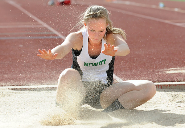 Niwot's Sara Bishop lands in the triple jump during the Broomfield Shoot Out Track Meet on Friday at Elizabeth Kennedy Stadium in Broomfield.<br /> March 30, 2012 <br /> staff photo/ David R. Jennings