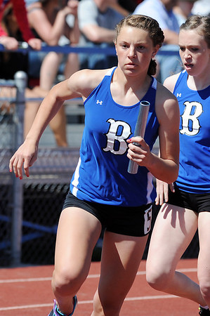 Broomfield's Christina Kennedy runs with the baton in the 800 medly relay during the Broomfield Shoot Out Track Meet on Friday at Elizabeth Kennedy Stadium in Broomfield.<br /> March 30, 2012 <br /> staff photo/ David R. Jennings