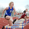 Broomfield's Kate Summerfield jumps over a hurdle in the 300m hurdles  during the Broomfield Shoot Out Track Meet on Friday at Elizabeth Kennedy Stadium in Broomfield.<br /> March 30, 2012 <br /> staff photo/ David R. Jennings