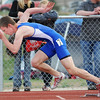 Broomfield's Jack Reece launches off the blocks for the 400 m dash during the Broomfield Shoot Out Track Meet on Friday at Elizabeth Kennedy Stadium in Broomfield.<br /> March 30, 2012 <br /> staff photo/ David R. Jennings