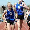 Broomfield's Anna Grace Knudtsen takes the baton from Kathryn Midel-Katzenmeyer in the 4 X 80 relay during the Broomfield Shoot Out Track Meet on Friday at Elizabeth Kennedy Stadium in Broomfield.<br /> March 30, 2012 <br /> staff photo/ David R. Jennings
