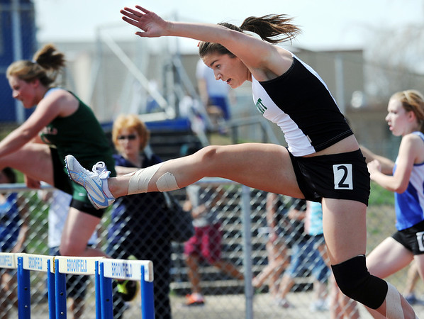 Niwot's Victoria Schultz runs in the 100 m hurdles during the Broomfield Shoot Out Track Meet on Friday at Elizabeth Kennedy Stadium in Broomfield.<br /> March 30, 2012 <br /> staff photo/ David R. Jennings