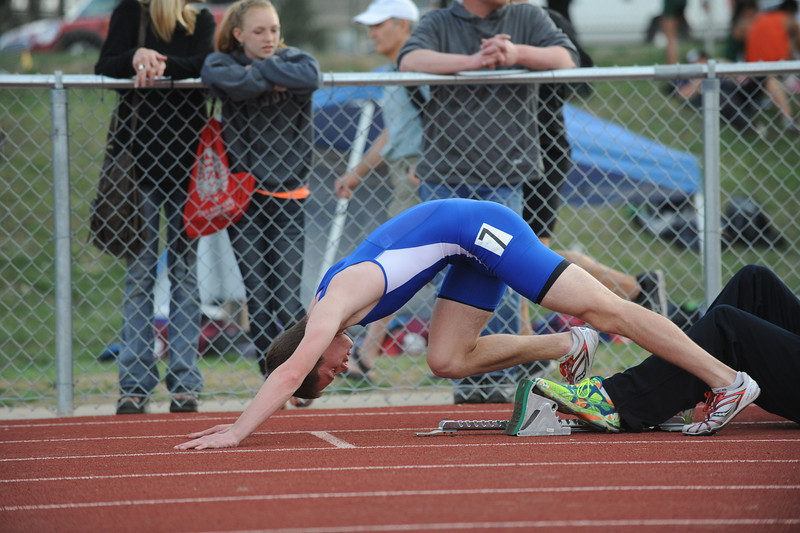 Broomfield's Jack Reece stretches into the blocks for the 400 m dash during the Broomfield Shoot Out Track Meet on Friday at Elizabeth Kennedy Stadium in Broomfield.<br /> March 30, 2012 <br /> staff photo/ David R. Jennings