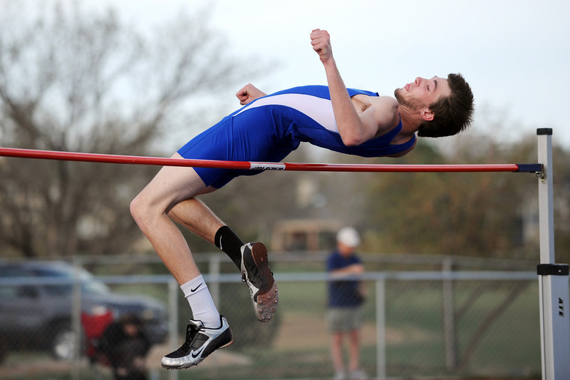 Broomfield's Jayson Dupre high jumps at the 5' 10'' height during the Broomfield Shoot Out Track Meet on Friday at Elizabeth Kennedy Stadium in Broomfield.<br /> March 30, 2012 <br /> staff photo/ David R. Jennings