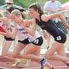 Boulder's Sam Lewis, right, begins the 1600m runs with Monarch's Taylor Floming and Kaitlyn Benner during the Broomfield Shoot Out Track Meet on Friday at Elizabeth Kennedy Stadium in Broomfield.<br /> March 30, 2012 <br /> staff photo/ David R. Jennings