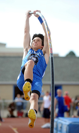 Longmont's Steven Wacker clears 14 feet in the pole vault during the Broomfield Shoot Out Track Meet on Friday at Elizabeth Kennedy Stadium in Broomfield.March 30, 2012 <br /> staff photo/ David R. Jennings