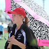 Monarch's Maccy Leonard waits in the shade of an umbrella for her turn at the high jump during the Broomfield Shoot Out Track Meet on Friday at Elizabeth Kennedy Stadium in Broomfield.<br /> March 30, 2012 <br /> staff photo/ David R. Jennings