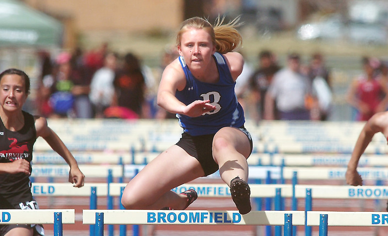 Kate Summerfield running in the 100m hurdles during the Broomfield Shoot Out Track Meet on Friday at Elizabeth Kennedy Stadium in Broomfield.<br /> March 30, 2012 <br /> staff photo/ David R. Jennings