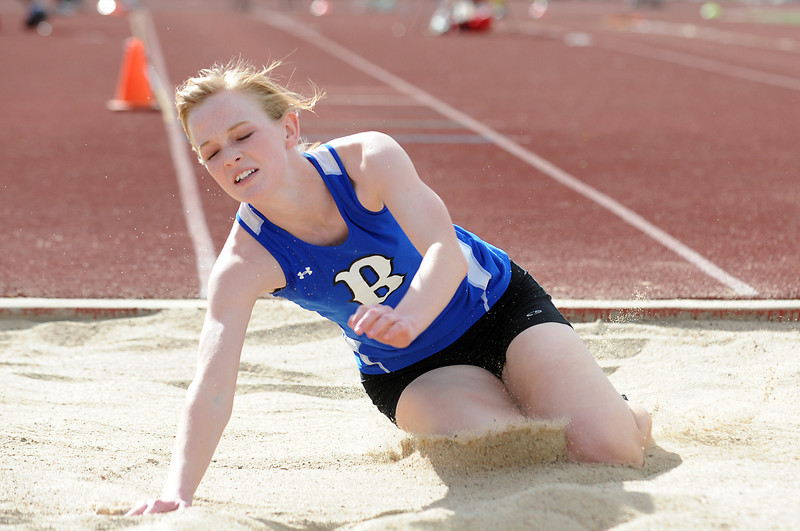 Sarah Hughs lands in the triple jump during the Broomfield Shoot Out Track Meet on Friday at Elizabeth Kennedy Stadium in Broomfield.<br /> March 30, 2012 <br /> staff photo/ David R. Jennings