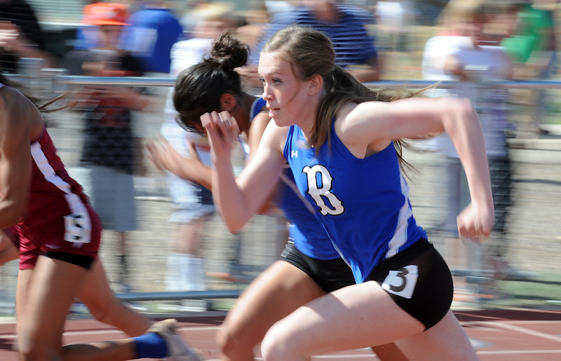 Broomfield's Alexi Cox running in the 100m dash during the Broomfield Shoot Out Track Meet on Friday at Elizabeth Kennedy Stadium in Broomfield.<br /> March 30, 2012 <br /> staff photo/ David R. Jennings
