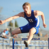 Broomfield's Scott Dickinson jumps over a hurdle in the 300m hurdles during the Broomfield Shoot Out Track Meet on Friday at Elizabeth Kennedy Stadium in Broomfield.<br /> March 30, 2012 <br /> staff photo/ David R. Jennings