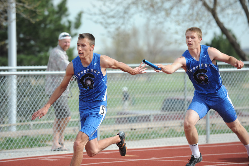 Longmont's Brandon Wilson, left, takes the baton from Ryan Bant-Cosburn in the 4 X 200 relay during the Broomfield Shoot Out Track Meet on Friday at Elizabeth Kennedy Stadium in Broomfield.<br /> March 30, 2012 <br /> staff photo/ David R. Jennings