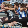 Kayla Wein, center, Broomfield, running in the 100m hurdles during the Broomfield track meet at Elizabeth Kennedy Stadium on Saturday.<br /> April 3, 2010<br /> Staff photo/David R. Jennings