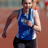 Jill Carlson, Broomfield, running the final leg of the 3200m relay during the Broomfield track meet at Elizabeth Kennedy Stadium on Saturday.<br /> April 3, 2010<br /> Staff photo/David R. Jennings
