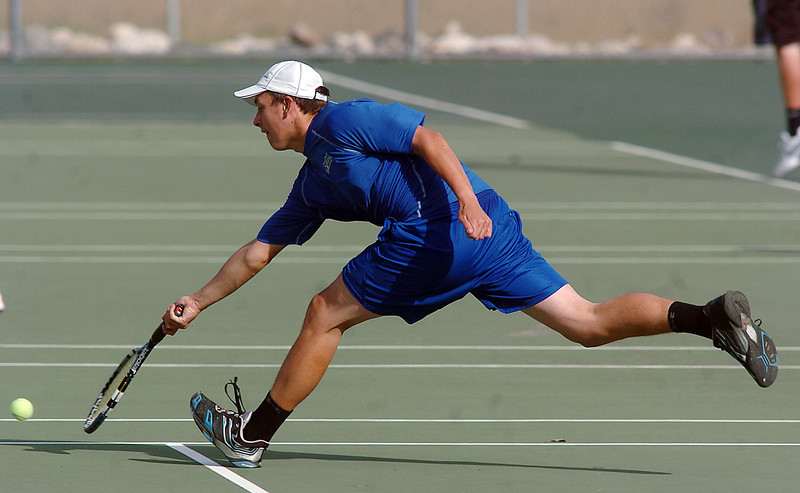 Broomfield's Jake Gardner,returns the ball to Silver Creek's Noah Grainer during play at Silver Creek on Tuesday.<br />                                                                                                                                                                                                                                                                                                                                                                                                                                                                                                                                                                                                                                                                                                                                      September 20, 2011<br /> staff photo/ David R. Jennings