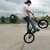 Logan Fox, 13, performs a stunt on his bike at the Broomfield Skate Park on Tuesday.<br /> <br /> August 4, 2009<br /> staff photo/David R. Jennings