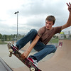 Kyle Martin, 16, performs a trick on his skate board at the Broomfield Skate Park on Tuesday.<br /> <br /> <br /> August 4, 2009<br /> staff photo/David R. Jennings