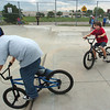 Joey Buttrey, 12, left, and Jayce Wilpolt, 10, ride their bikes in the Broomfield Skate Park on Tuesday.<br /> <br /> August 4, 2009<br /> staff photo/David R. Jennings