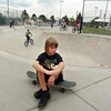 Carson Corda, 9, sits on his skate board at the Broomfield Skate Park on Tuesday.<br /> <br /> <br /> August 4, 2009<br /> staff photo/David R. Jennings