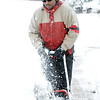 John Mosley uses a snowblower to clear his and his neighbor's sidewalks along Laurel Street during the February 3rd snowstorm.<br /> February 3, 2012<br /> staff photo/ David R. Jennings